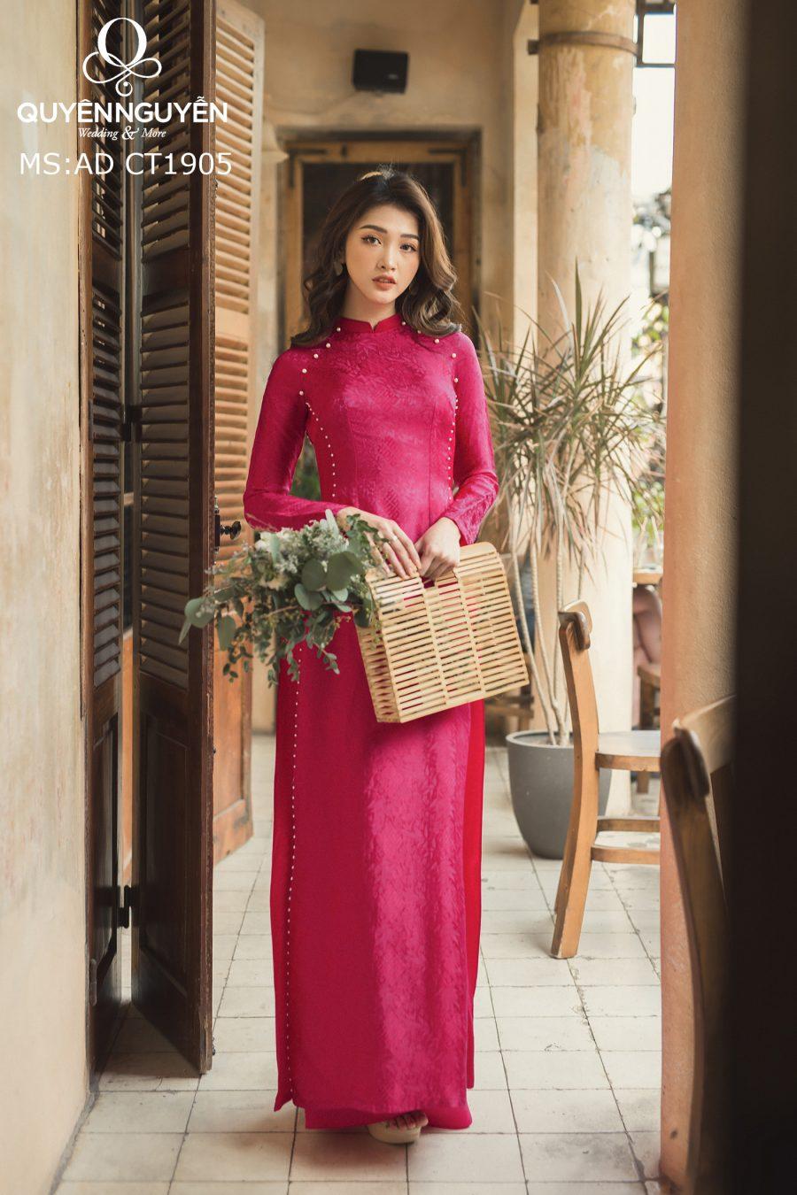 Áo dài lụa là hồng cánh sen họa tiết gấm đính khuy ngọc trai AD CT-1905