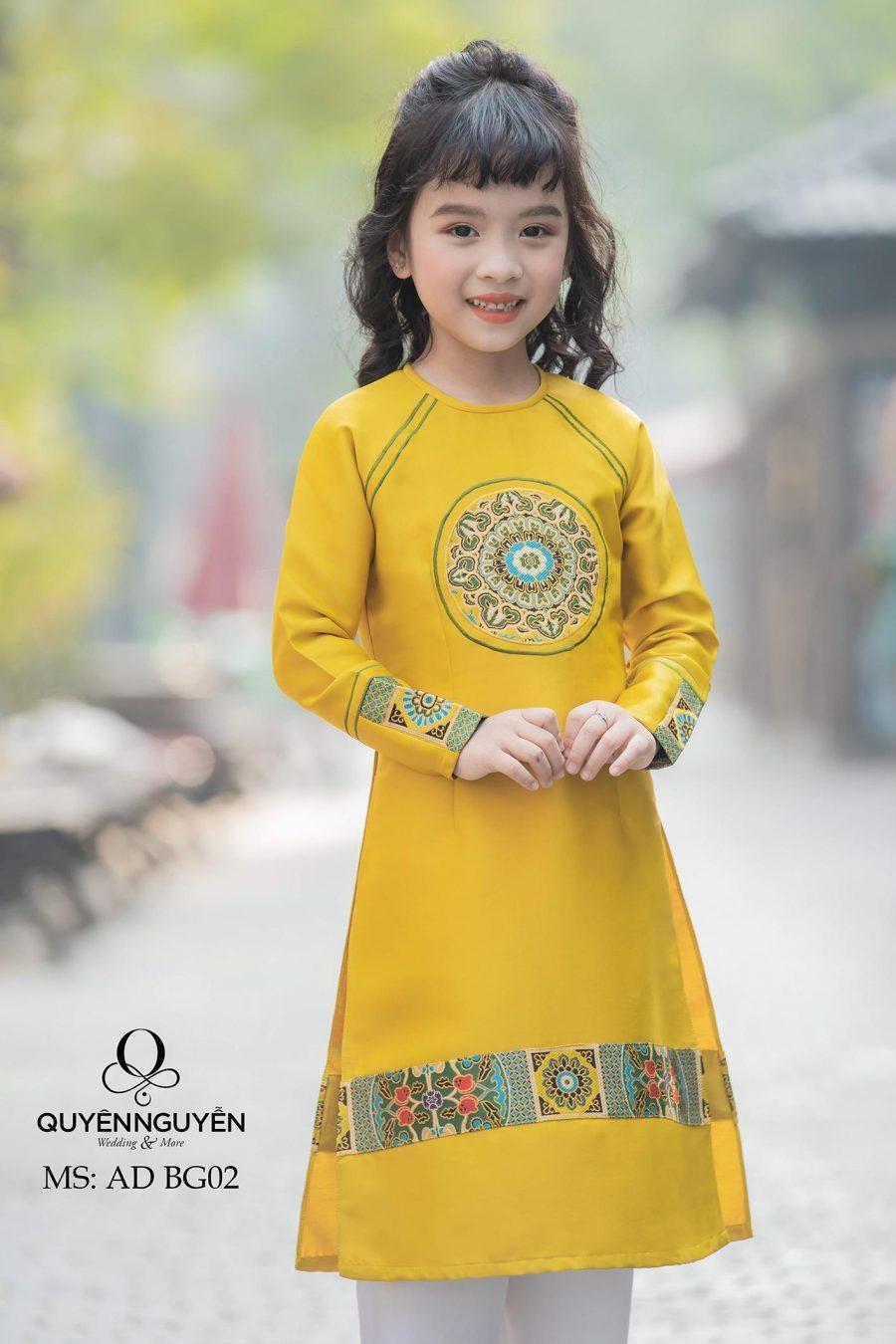 Áo dài bé gái màu vàng in họa tiết gấm dân tộc AD BG02