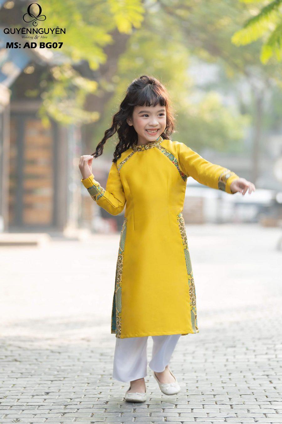 Áo dài bé gái vàng họa tiết gấm nổi bật AD BG07