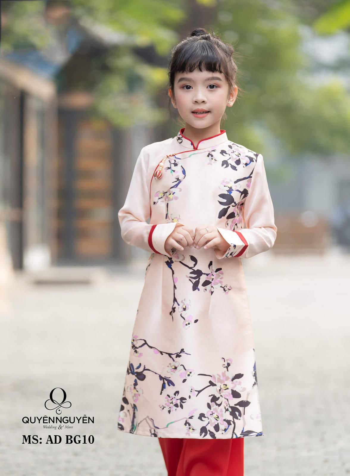 Áo dài trẻ em tông hồng phấn in cành đào