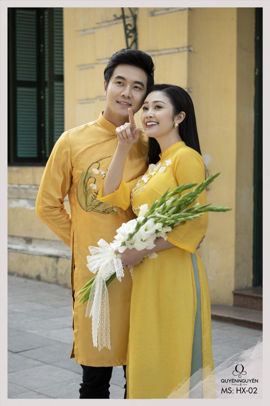 Áo dài Tết vàng xanh thêu hoa nổi HX02