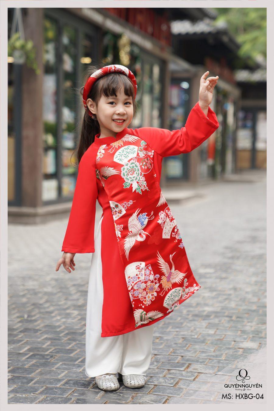 Áo dài cách tân bé gái gấm hạc đỏ đón xuân HXBG04