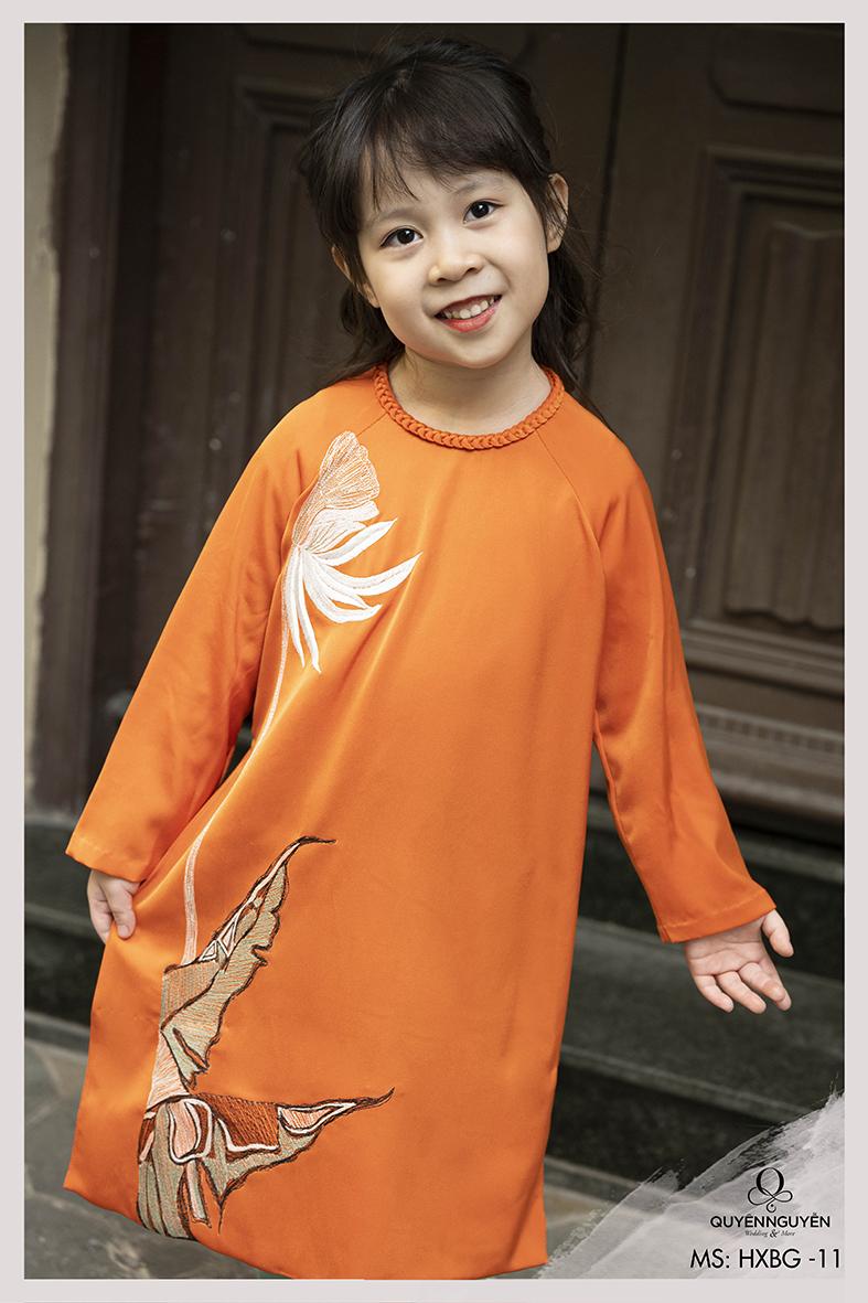 Áo  bé gái màu cam thêu lá thiên điểu HXBG11