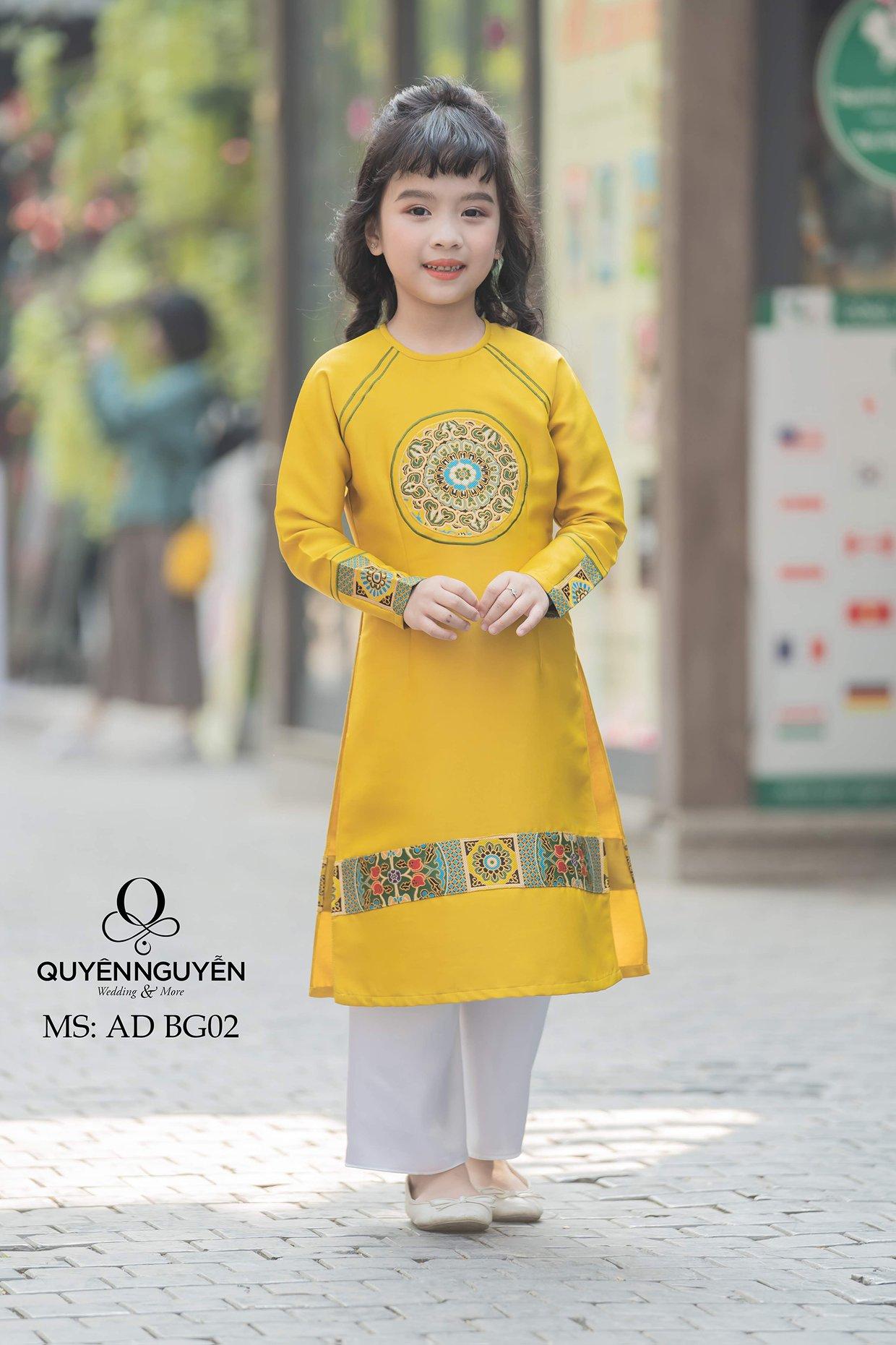 Áo dài trẻ em cách tân màu vàng với họa tiết đối xứng ADBG02