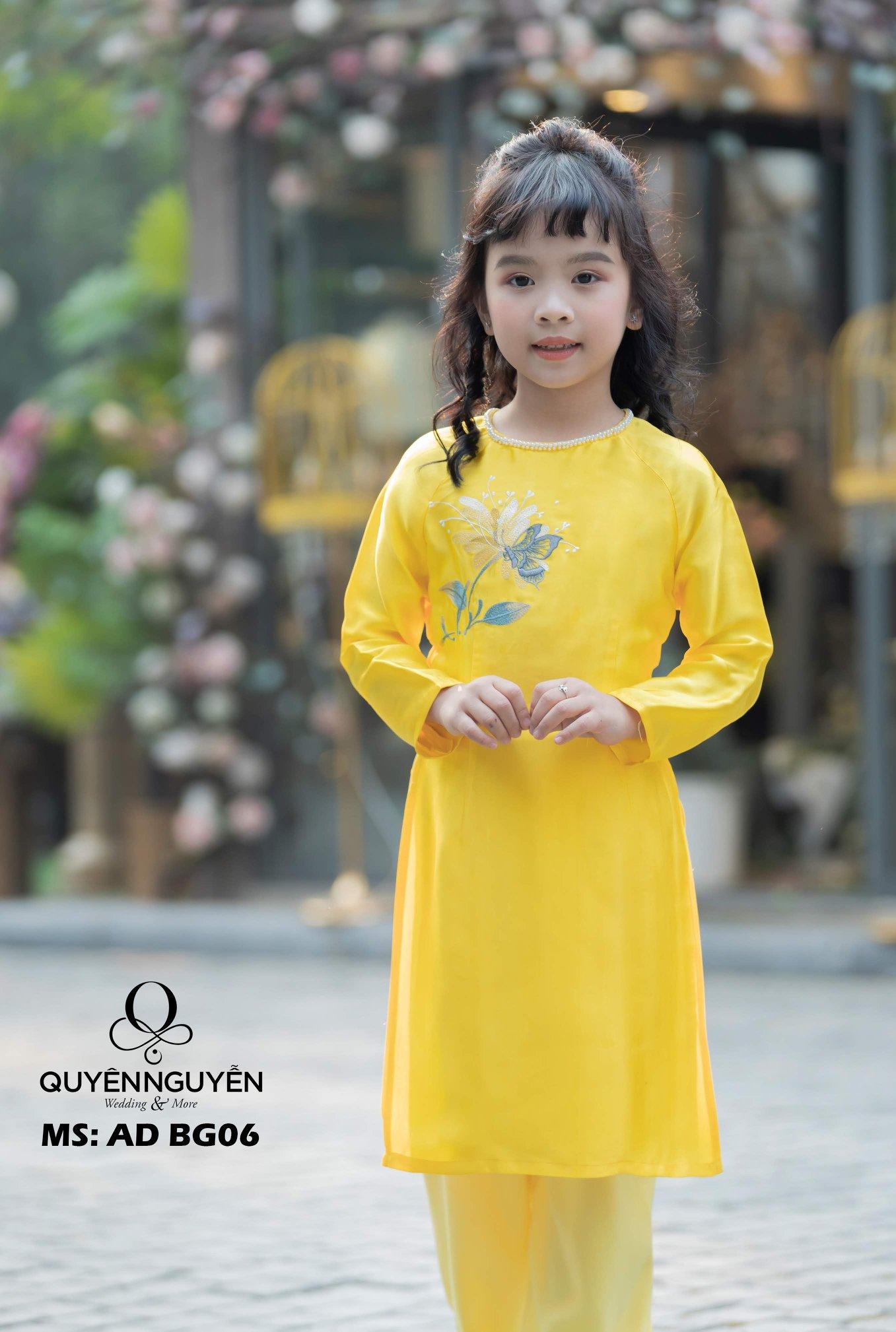Áo dài trẻ em cách tân màu vàng cổ tròn đính ngọc ADBG06